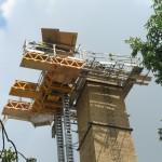 Bennu Scaffolding Platform Series 3 and 66ft. telehandler machines help disassemble Illinois Burbank School smoke stack